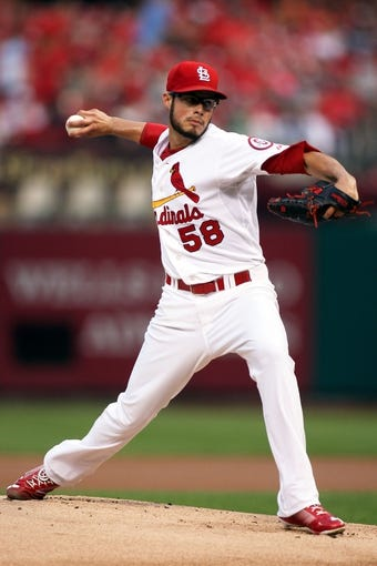 Aug 22, 2013; St. Louis, MO, USA; St. Louis Cardinals starting pitcher Joe Kelly (58) pitches in the first inning against the Atlanta Braves at Busch Stadium. Mandatory Credit: Scott Kane-USA TODAY Sports