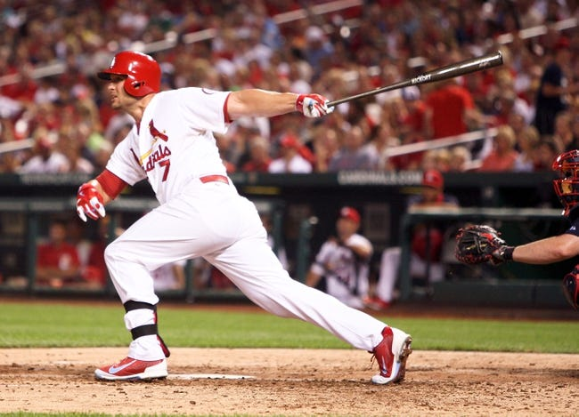 Aug 22, 2013; St. Louis, MO, USA; St. Louis Cardinals left fielder Matt Holliday (7) hits for a double in the fourth inning against the Atlanta Braves at Busch Stadium. Mandatory Credit: Scott Kane-USA TODAY Sports