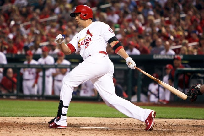 Aug 22, 2013; St. Louis, MO, USA; St. Louis Cardinals right fielder Carlos Beltran (3) bats for an RBI double in the fifth inning against the Atlanta Braves at Busch Stadium. Mandatory Credit: Scott Kane-USA TODAY Sports
