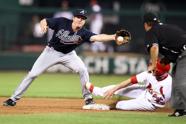 Aug 22, 2013; St. Louis, MO, USA; St. Louis Cardinals center fielder Shane Robinson (43) safely slides into second base as Atlanta Braves second baseman Elliot Johnson (30) reaches for the ball in the sixth inning at Busch Stadium. Mandatory Credit: Scott Kane-USA TODAY Sports