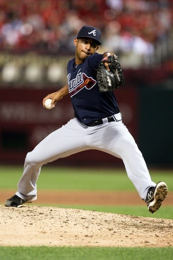 Aug 22, 2013; St. Louis, MO, USA; Atlanta Braves relief pitcher Anthony Varvaro (38) pitches in the seventh inning against the St. Louis Cardinals at Busch Stadium. Mandatory Credit: Scott Kane-USA TODAY Sports