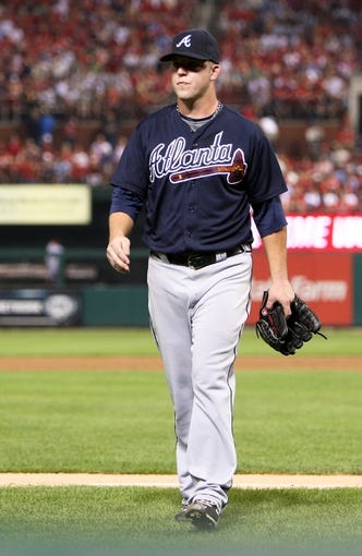 Aug 22, 2013; St. Louis, MO, USA; Atlanta Braves starting pitcher Paul Maholm (28) returns to the in the dugout after being relieved in the sixth inning at Busch Stadium. The Cardinals defeated the Braves 6-2. Mandatory Credit: Scott Kane-USA TODAY Sports