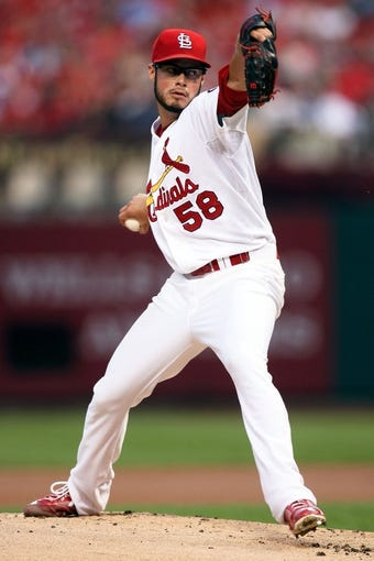 Aug 22, 2013; St. Louis, MO, USA; St. Louis Cardinals starting pitcher Joe Kelly (58) pitches against the Atlanta Braves at Busch Stadium. The Cardinals defeated the Braves 6-2. Mandatory Credit: Scott Kane-USA TODAY Sports