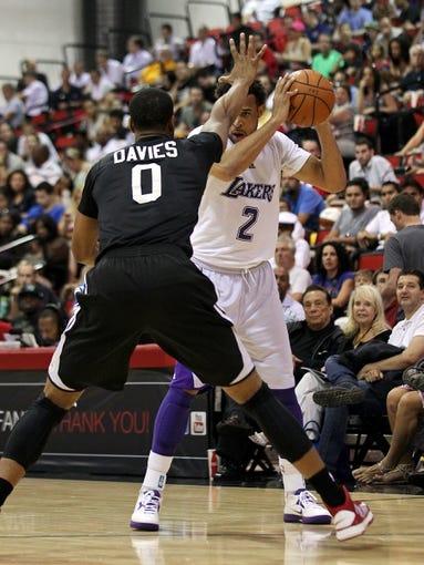 Jul 15, 2013; Las Vegas, NV, USA; Los Angeles Lakers forward Elias Harris (2) controls the ball against Los Angeles Clippers center Brandon Davies (0) during an NBA Summer League game at Cox Pavillion. Mandatory Credit: Stephen R. Sylvanie-USA TODAY Sports