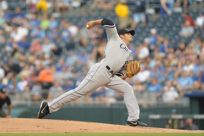 Aug 21, 2013; Kansas City, MO, USA; Chicago White Sox starting pitcher Andre Rienzo (64) delivers a pitch in the first inning of the game against the Kansas City Royals at Kauffman Stadium. Chicago won 5-2. Mandatory Credit: Denny Medley-USA TODAY Sports