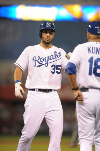 Aug 21, 2013; Kansas City, MO, USA; Kansas City Royals first baseman Eric Hosmer (35) is congratulated by first base coach Rusty Kuntz (18) after hitting a single in the sixth inning of the game against the Chicago White Sox at Kauffman Stadium. Chicago won 5-2. Mandatory Credit: Denny Medley-USA TODAY Sports