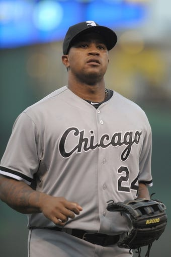 Aug 21, 2013; Kansas City, MO, USA; Chicago White Sox left fielder Dayan Viciedo (24) walks to the dugout in between innings of the game against the Kansas City Royals at Kauffman Stadium. Chicago won 5-2. Mandatory Credit: Denny Medley-USA TODAY Sports