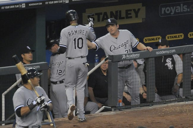 Aug 21, 2013; Kansas City, MO, USA; Chicago White Sox shortstop Alexei Ramirez (10) is congratulated by batting coach Jeff Manto (31) after scoring in the fifth inning of the game against the Kansas City Royals at Kauffman Stadium. Chicago won 5-2. Mandatory Credit: Denny Medley-USA TODAY Sports