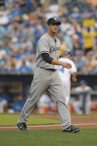 Aug 21, 2013; Kansas City, MO, USA; Chicago White Sox starting pitcher Andre Rienzo (64) walks to the dugout in between innings of the game against the Kansas City Royals at Kauffman Stadium. Chicago won 5-2. Mandatory Credit: Denny Medley-USA TODAY Sports