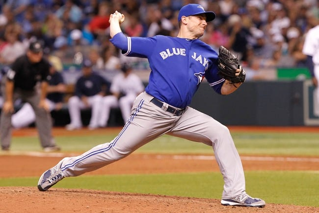 Aug 17, 2013; St. Petersburg, FL, USA; Toronto Blue Jays relief pitcher Neil Wagner (45) throws a pitch against the Tampa Bay Rays at Tropicana Field. Toronto Blue Jays defeated the Tampa Bay Rays 6-2. Mandatory Credit: Kim Klement-USA TODAY Sports