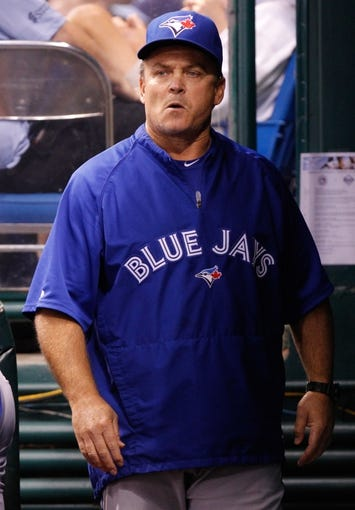 Aug 17, 2013; St. Petersburg, FL, USA; Toronto Blue Jays manager John Gibbons (5) against the Tampa Bay Rays at Tropicana Field. Toronto Blue Jays defeated the Tampa Bay Rays 6-2. Mandatory Credit: Kim Klement-USA TODAY Sports