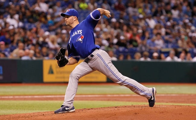 Aug 17, 2013; St. Petersburg, FL, USA; Toronto Blue Jays starting pitcher J.A. Happ (48) throws a pitch against the Tampa Bay Rays at Tropicana Field. Mandatory Credit: Kim Klement-USA TODAY Sports