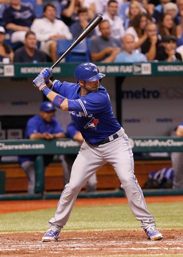 Aug 17, 2013; St. Petersburg, FL, USA; Toronto Blue Jays catcher J.P. Arencibia (9) at bat against the Tampa Bay Rays at Tropicana Field. Mandatory Credit: Kim Klement-USA TODAY Sports