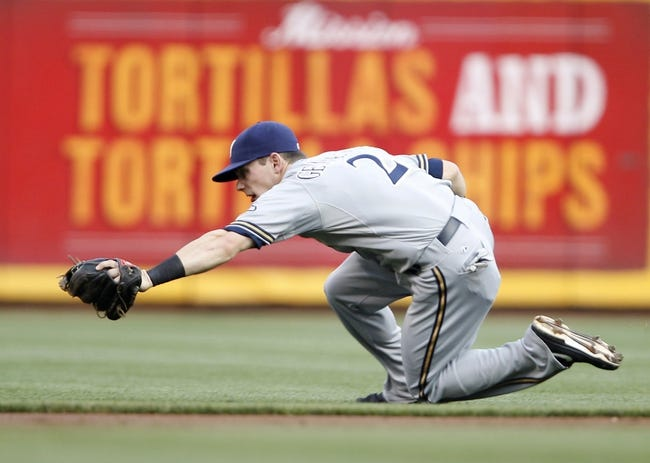 Aug 23, 2013; Cincinnati, OH, USA; Milwaukee Brewers second baseman Scooter Gennett (2) makes a play during the first inning against the Cincinnati Reds at Great American Ball Park. Mandatory Credit: Frank Victores-USA TODAY Sports