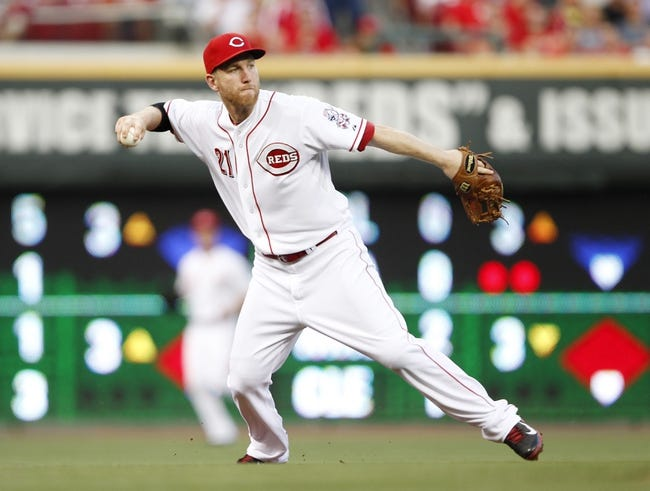 Aug 23, 2013; Cincinnati, OH, USA; Cincinnati Reds third baseman Todd Frazier (21) makes a play during the third inning against the Milwaukee Brewers at Great American Ball Park. Mandatory Credit: Frank Victores-USA TODAY Sports