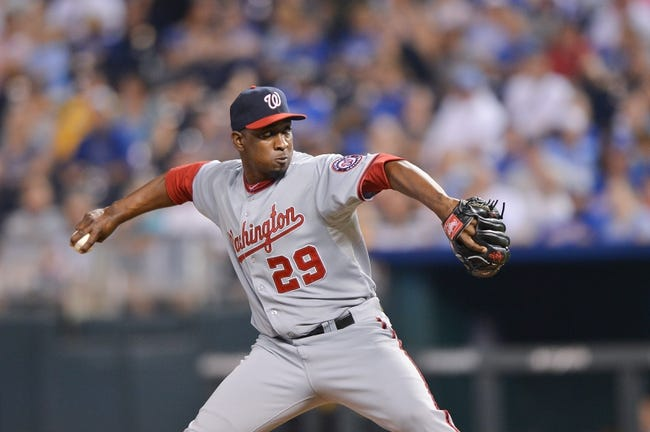Aug 23, 2013; Kansas City, MO, USA; Washington Nationals pitcher Rafael Soriano (29) delivers a pitch against the Kansas City Royals during the ninth inning at Kauffman Stadium.  Washington beat Kansas City 11-10. Mandatory Credit: Peter G. Aiken-USA TODAY Sports
