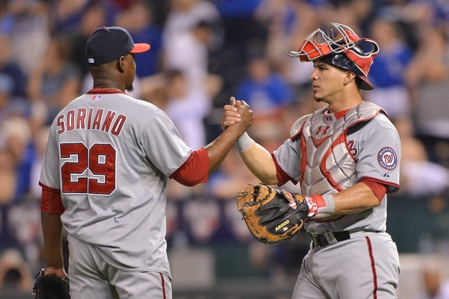Aug 23, 2013; Kansas City, MO, USA; Washington Nationals pitcher Rafael Soriano (29) shakes hands with catcher Wilson Ramos (40) after beating the Kansas City Royals 11-10 at Kauffman Stadium.  Mandatory Credit: Peter G. Aiken-USA TODAY Sports