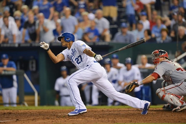 Aug 23, 2013; Kansas City, MO, USA; Kansas City Royals right fielder Justin Maxwell (27) singles in two-runs against the Washington Nationals during the ninth inning at Kauffman Stadium.  Washington beat Kansas City 11-10. Credit: Peter G. Aiken-USA TODAY Sports