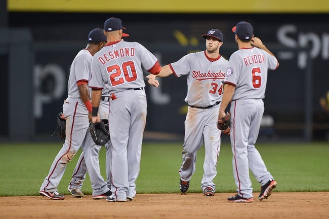 Aug 23, 2013; Kansas City, MO, USA; Washington Nationals right fielder Bryce Harper (34) shakes hands with teammates Ian Desmond (20) and Anthony Rendon (6) after beating the Kansas City Royals 11-10 at Kauffman Stadium.  Mandatory Credit: Peter G. Aiken-USA TODAY Sports