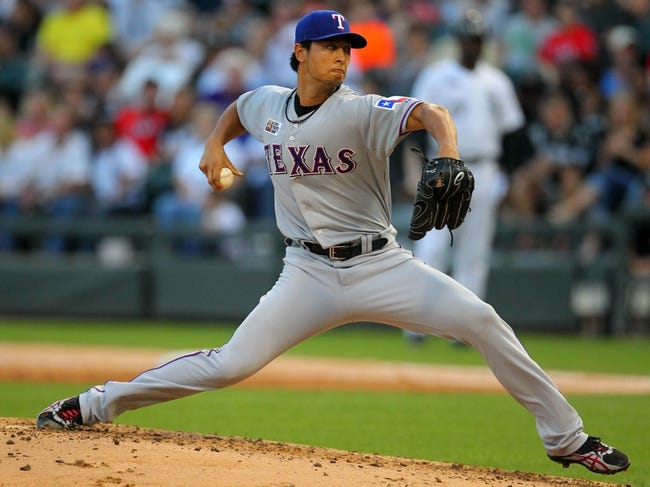 Aug 24, 2013; Chicago, IL, USA; Texas Rangers starting pitcher Yu Darvish (11) throws a pitch during the second inning against the Chicago White Sox at US Cellular Field. Mandatory Credit: Dennis Wierzbicki-USA TODAY Sports
