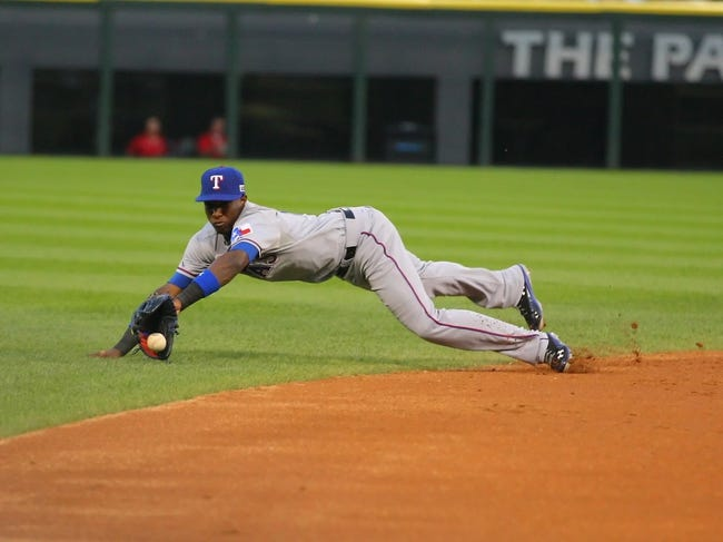 Aug 24, 2013; Chicago, IL, USA; Texas Rangers shortstop Jurickson Profar (13) fields an infield single off the bat of Chicago White Sox left fielder Dayan Viciedo (not pictured) during the third inning at US Cellular Field. Mandatory Credit: Dennis Wierzbicki-USA TODAY Sports