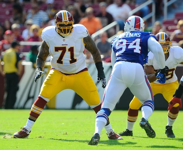 Aug 24, 2013; Landover, MD, USA; Washington Redskins offensive tackle Trent Williams (71) blocks Buffalo Bills defensive end Mario Williams (94) during the first half  at FedEX Field. Mandatory Credit: Brad Mills-USA TODAY Sports