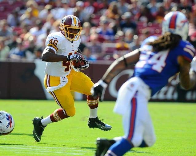 Aug 24, 2013; Landover, MD, USA; Washington Redskins running back Alfred Morris (46) runs with the ball during the first half against the Buffalo Bills at FedEX Field. Mandatory Credit: Brad Mills-USA TODAY Sports