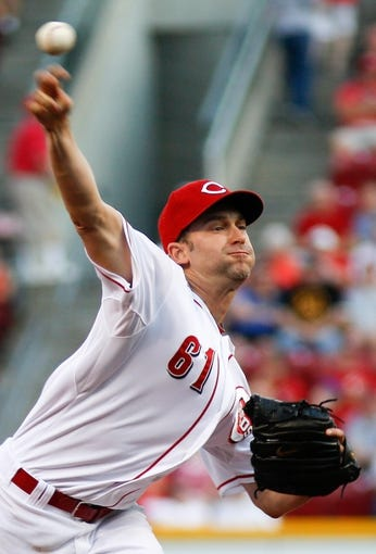 Aug 24, 2013; Cincinnati, OH, USA; Cincinnati Reds starting pitcher Bronson Arroyo (61) throws a pitch against the Milwaukee Brewers in the first inning at Great American Ball Park. Mandatory Credit: David Kohl-USA TODAY Sports