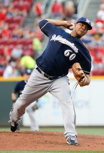 Aug 24, 2013; Cincinnati, OH, USA; Milwaukee Brewers starting pitcher Wily Peralta (60) throws against the Cincinnati Reds in the first inning at Great American Ball Park. Mandatory Credit: David Kohl-USA TODAY Sports
