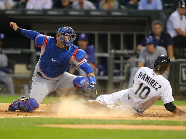 Aug 24, 2013; Chicago, IL, USA; Chicago White Sox shortstop Alexei Ramirez (10) is tagged out at home by Texas Rangers catcher A.J. Pierzynski (12) during the fourth inning at US Cellular Field. Mandatory Credit: Dennis Wierzbicki-USA TODAY Sports