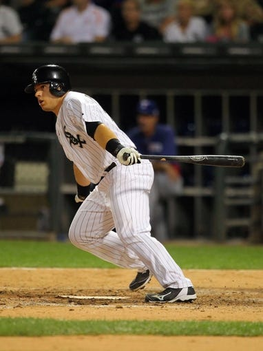 Aug 24, 2013; Chicago, IL, USA; Chicago White Sox catcher Josh Phegley (36) hits a game-winning RBI single during the ninth inning against the Texas Rangers at US Cellular Field. Chicago won 3-2. Mandatory Credit: Dennis Wierzbicki-USA TODAY Sports