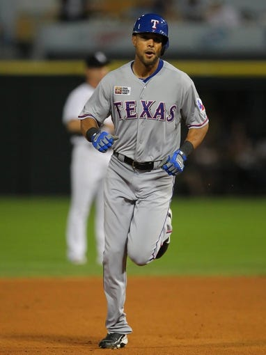 Aug 24, 2013; Chicago, IL, USA; Texas Rangers right fielder Alex Rios (51) runs between second and third base during his 2 RBI home run hit during the sixth inning against the Chicago White Sox at US Cellular Field. Chicago won 3-2. Mandatory Credit: Dennis Wierzbicki-USA TODAY Sports