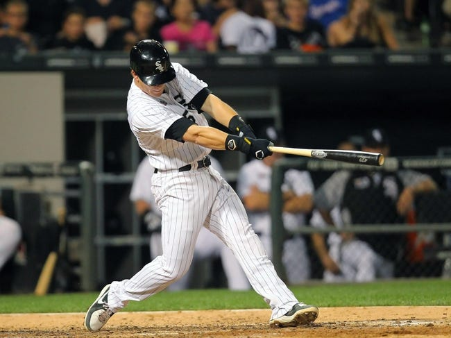 Aug 24, 2013; Chicago, IL, USA; Chicago White Sox second baseman Gordon Beckham (15) hits a single during the sixth inning against the Texas Rangers at US Cellular Field. Chicago won 3-2. Mandatory Credit: Dennis Wierzbicki-USA TODAY Sports