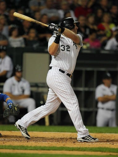 Aug 24, 2013; Chicago, IL, USA; Chicago White Sox first baseman Adam Dunn (32) hits a two run home run during the sixth inning against the Texas Rangers at US Cellular Field. Chicago won 3-2. Mandatory Credit: Dennis Wierzbicki-USA TODAY Sports