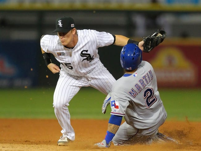 Aug 24, 2013; Chicago, IL, USA; Texas Rangers center fielder Leonys Martin (2) slides under the tag of Chicago White Sox second baseman Gordon Beckham (15) during the seventh inning at US Cellular Field. Chicago won 3-2. Mandatory Credit: Dennis Wierzbicki-USA TODAY Sports