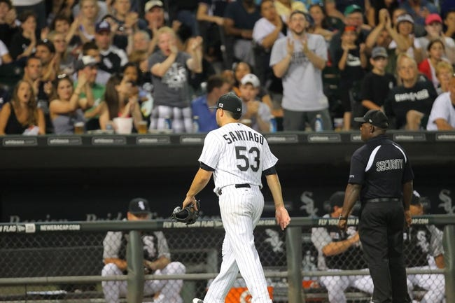 Aug 24, 2013; Chicago, IL, USA; Chicago White Sox starting pitcher Hector Santiago (53) is cheered by fans during the seventh inning against the Texas Rangers at US Cellular Field. Chicago won 3-2. Mandatory Credit: Dennis Wierzbicki-USA TODAY Sports