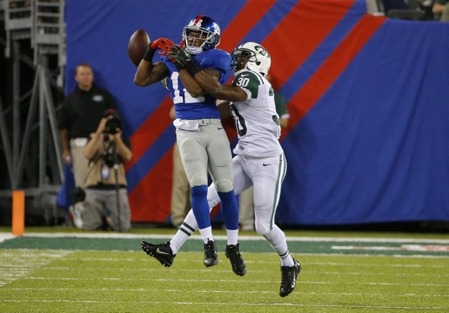 Aug 24, 2013; East Rutherford, NJ, USA; New York Jets cornerback Darrin Walls (30) breaks up a reception by New York Giants wide receiver Jerrel Jernigan (12) during the second half at MetLife Stadium. New York Jets defeat the New York Giants 24-21 in OT. Mandatory Credit: Jim O'Connor-USA TODAY Sports