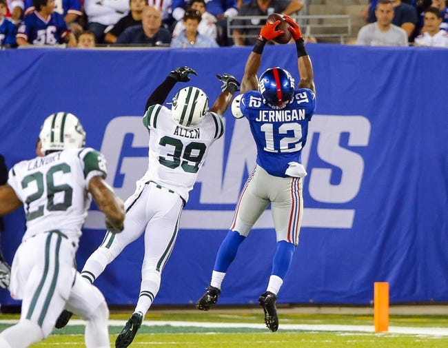 Aug 24, 2013; East Rutherford, NJ, USA; New York Giants wide receiver Jerrel Jernigan (12) makes reception against New York Jets safety Antonio Allen (39) during the first half at MetLife Stadium. Mandatory Credit: Jim O'Connor-USA TODAY Sports