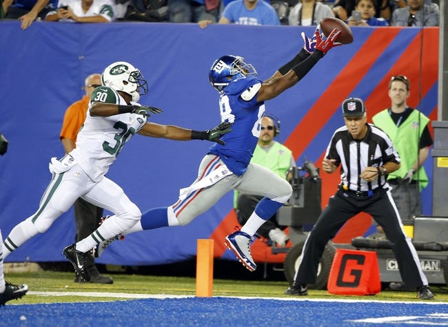 Aug 24, 2013; East Rutherford, NJ, USA; New York Giants wide receiver Hakeem Nicks (88) reaches for a pass but does not make the catch during the first half as he is covered by New York Jets cornerback Darrin Walls (30) at MetLife Stadium. Mandatory Credit: Jim O'Connor-USA TODAY Sports