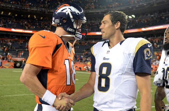 Aug 24, 2013; Denver, CO, USA; St. Louis Rams quarterback Sam Bradford (8) greets Denver Broncos quarterback Peyton Manning (18) following the preseason game against at Sports Authority Field .The Broncos defeated the Rams 27-26. Mandatory Credit: Ron Chenoy-USA TODAY Sports