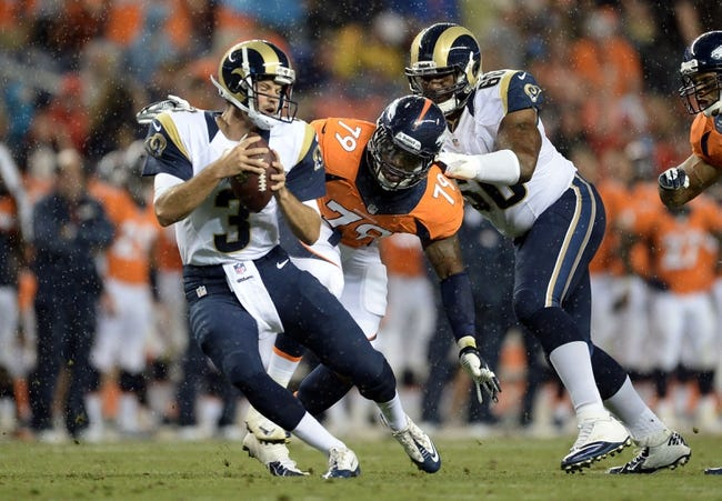Aug 24, 2013; Denver, CO, USA; Denver Broncos defensive end John Youboty (79) attempts to sack St. Louis Rams quarterback Tim Jenkins (3) in the fourth quarter at Sports Authority Field .The Broncos defeated the Rams 27-26. Mandatory Credit: Ron Chenoy-USA TODAY Sports