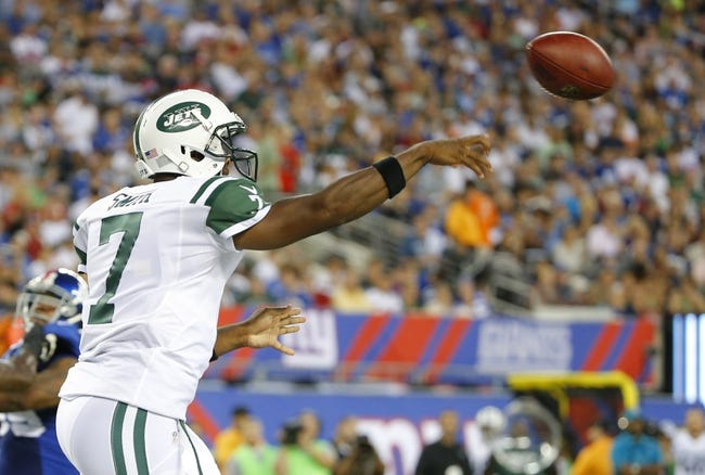 Aug 24, 2013; East Rutherford, NJ, USA; New York Jets quarterback Geno Smith (7) passes the ball during the first half against the New York Giants at MetLife Stadium. Mandatory Credit: Jim O'Connor-USA TODAY Sports