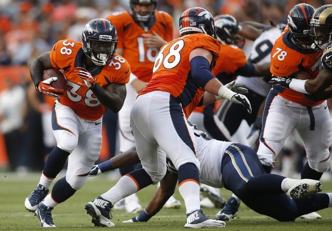 Aug 24, 2013; Denver, CO, USA; Denver Broncos running back Montee Ball (38) runs the ball during the first half against the St. Louis Rams at Sports Authority Field at Mile High. Mandatory Credit: Chris Humphreys-USA TODAY Sports