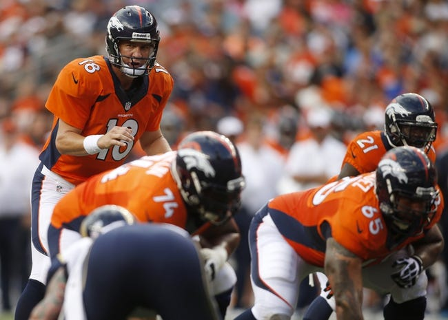 Aug 24, 2013; Denver, CO, USA; Denver Broncos quarterback Peyton Manning at the line of scrimmage during the first half against the St. Louis Rams at Sports Authority Field at Mile High. Mandatory Credit: Chris Humphreys-USA TODAY Sports