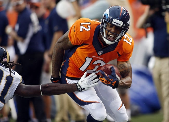 Aug 24, 2013; Denver, CO, USA; Denver Broncos wide receiver Andre Caldwell (12) catches a pass for a first down during the first half against the St. Louis Rams at Sports Authority Field at Mile High. Mandatory Credit: Chris Humphreys-USA TODAY Sports