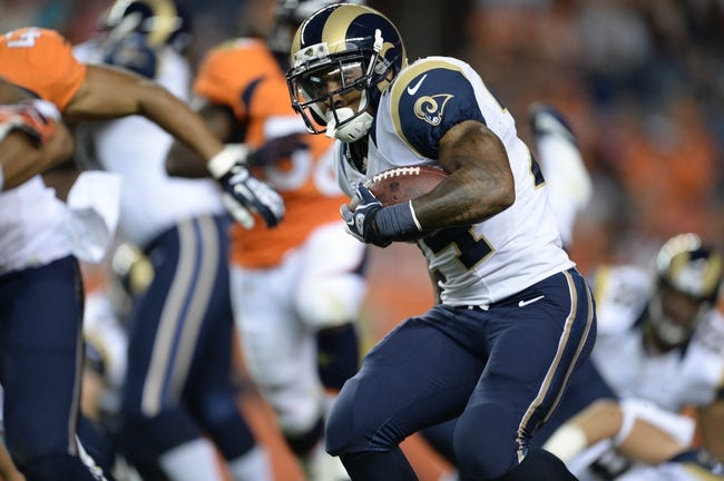Aug 24, 2013; Denver, CO, USA; St. Louis Rams running back Isaiah Pead (24) rushes during the preseason game against the Denver Broncos at Sports Authority Field .The Broncos defeated the Rams 27-26. Mandatory Credit: Ron Chenoy-USA TODAY Sports