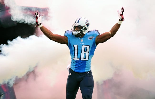 Aug 24, 2013; Nashville, TN, USA; Tennessee Titans wide receiver Kenny Britt (18) is introduced before a game against the Atlanta Falcons at LP Field. The Titans beat the Falcons 27-16. Mandatory Credit: Don McPeak-USA TODAY Sports