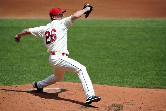 Aug 25, 2013; Cleveland, OH, USA; Cleveland Indians starting pitcher Scott Kazmir (26) delivers in the second inning against the Minnesota Twins at Progressive Field. Mandatory Credit: David Richard-USA TODAY Sports