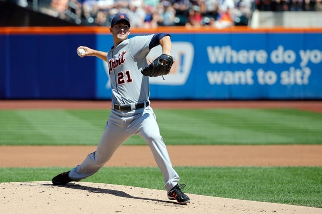 Aug 25, 2013; New York, NY, USA;  Detroit Tigers starting pitcher Rick Porcello (21) pitches during the first inning against the New York Mets at Citi Field. Mandatory Credit: Anthony Gruppuso-USA TODAY Sports