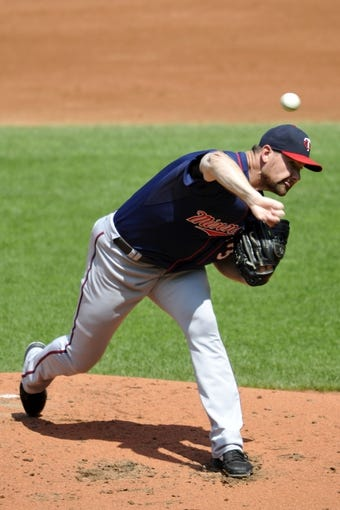 Aug 25, 2013; Cleveland, OH, USA; Minnesota Twins starting pitcher Mike Pelfrey (37) delivers in the second inning against the Cleveland Indians at Progressive Field. Mandatory Credit: David Richard-USA TODAY Sports